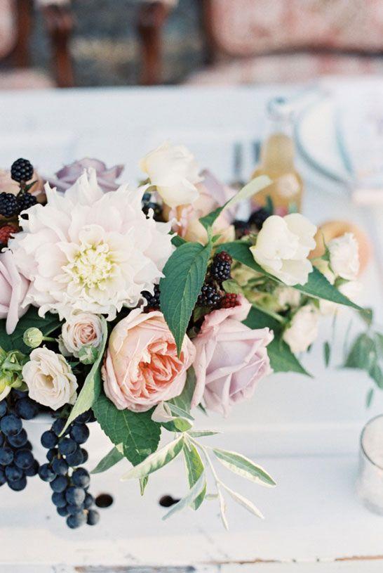 Lovely blush arrangement with navy blue accents. #wedding #floral #centerpiece