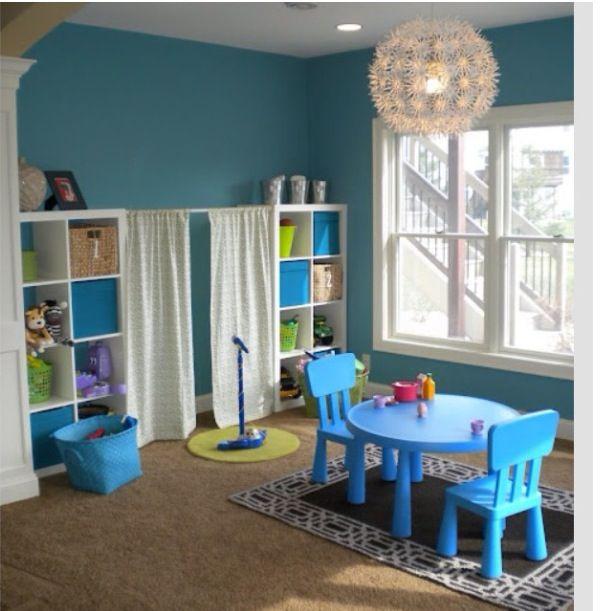 Cute idea - curtain rod between two bookshelves