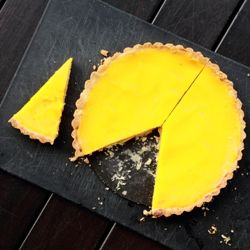 Bright and sunny meyer lemon tart made with an almond crust and sweet ...
