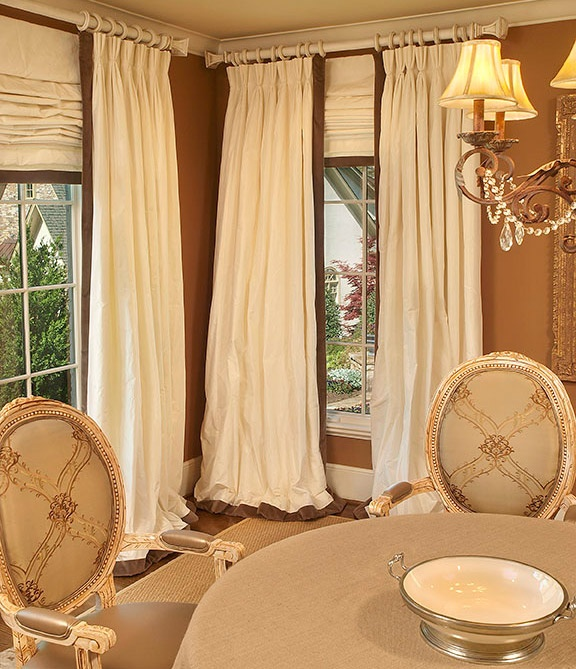 I not only love this room and all the warm, rich colors and furnishings, but I am madly in love with the window treatment. Interior Traci Zeller.