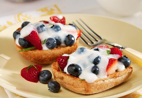 Fresh berries and yogurt are the perfect topping for honey drizzled ...