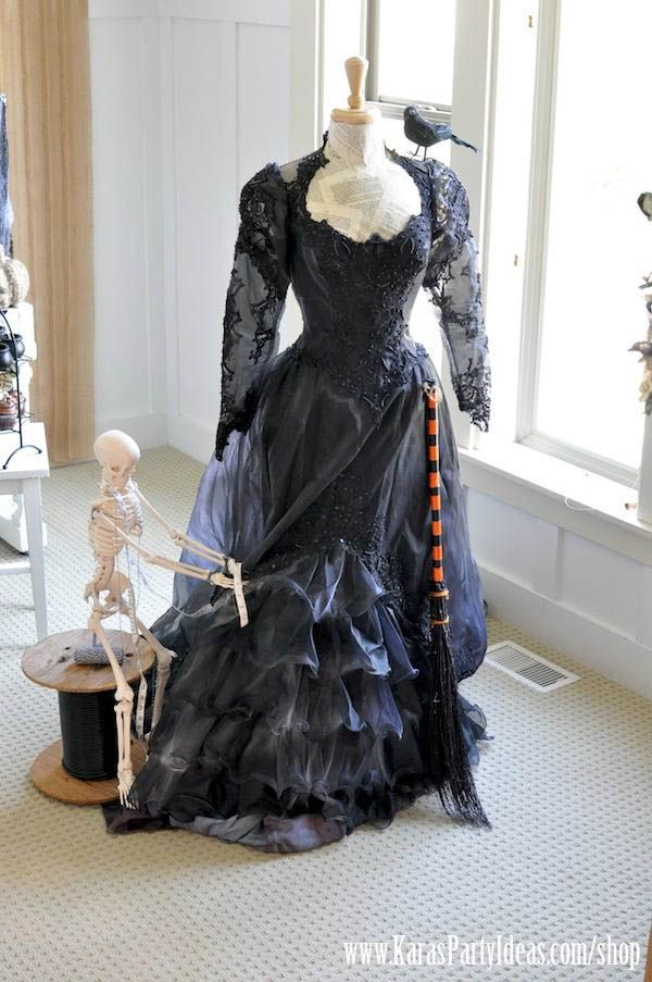 Witch's costume...purchase old wedding dress at thrift store and dye black...easy and cheap! OMG... great Idea!!!
