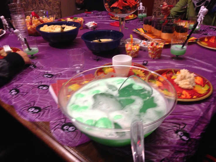 Halloween punch with ginger ale, lemon juice and rainbow sherbet!!!!!