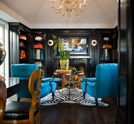 Black-painted cabinets perfect but, just love the peacock blue chairs!
