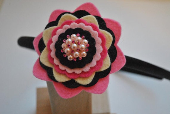 Stacked felt flower with vintage earring in center.