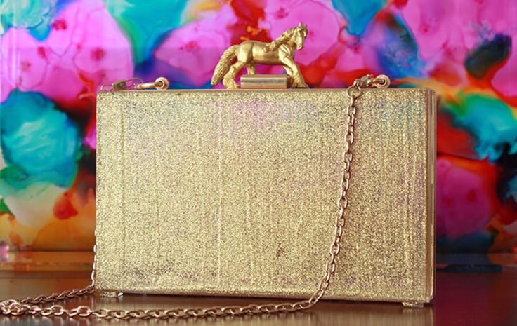 Endlessly Creative. Gold clutch