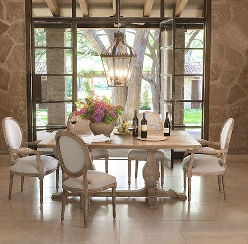 french country dining room stone walls french doors natural light