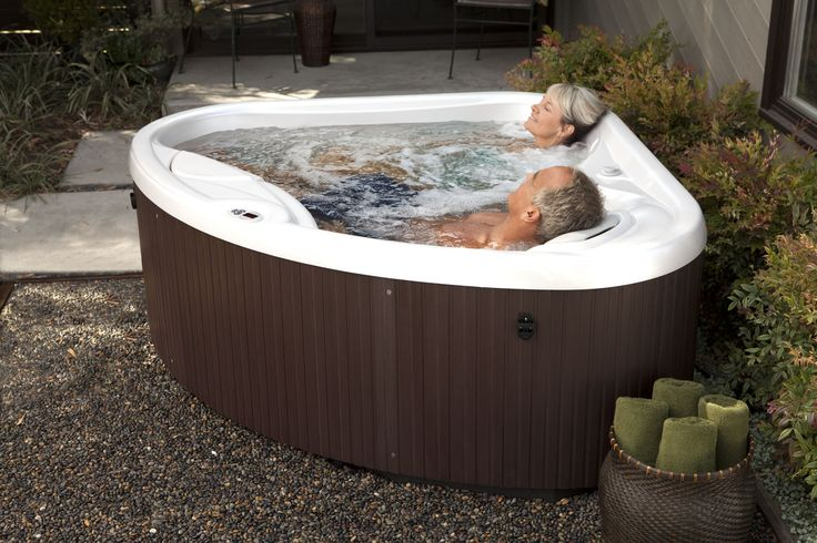 recharge with a hotspringspas compact hot tub perfect for any small
