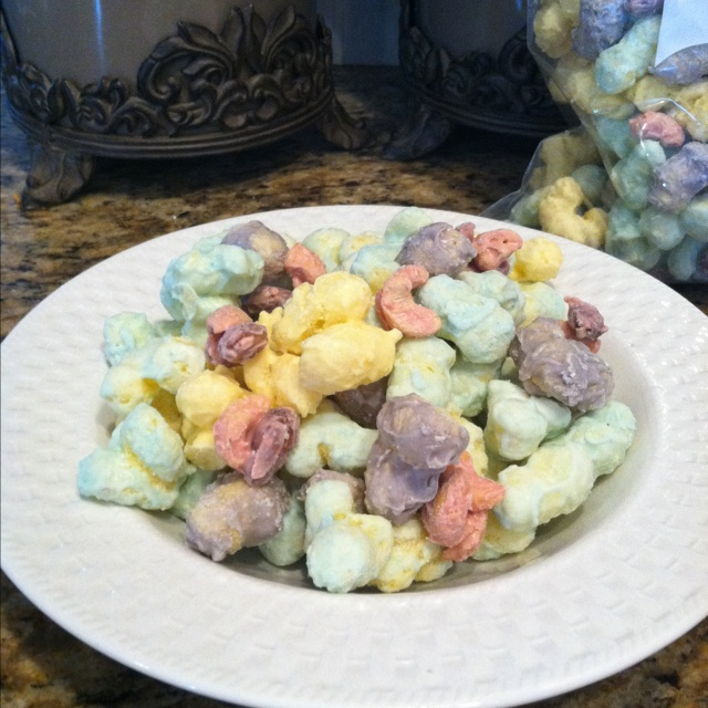 Easter Bunny Snack. Fun and easy sweet snack to make with my little girls.  Take one package of white almond bark (minus 2 squares) and melt in the microwave.  We used 3 different bowls and added a few drops of pastel food coloring for a festive look.  Mix in one bag of puffed corn, you can find this in the chip aisle.  Stir until coated with a rubber spatula and then spread out onto a large sheet of waxed paper. Melt the remaining squares of almond bark in a separate bowl in the microwave an...
