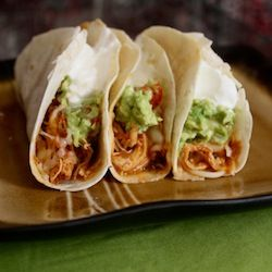 Crockpot Chicken Tacos made with only three ingredients - easily one of my top 5 favorite recipes!