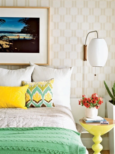 california casual bedroom in yellow and Kelly green. Nice subtle graphic wallpaper in creme and beige.