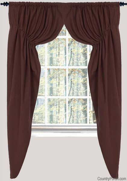 Love the prarie style curtain.