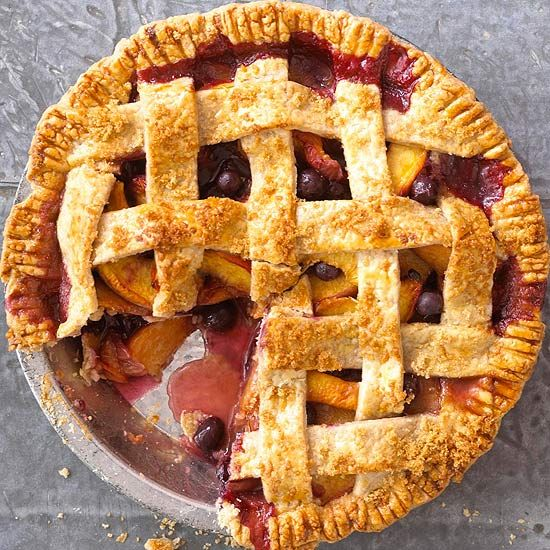 bright and cheery pie is filled with fresh peaches and blueberries ...