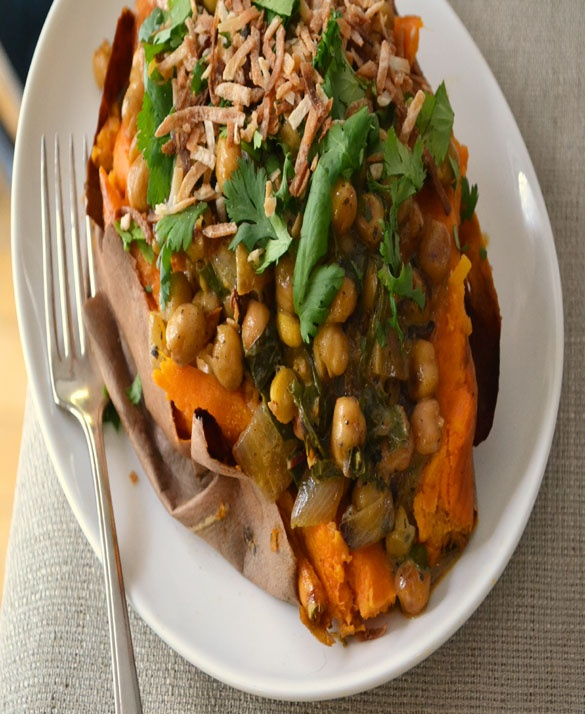 Braised Coconut Spinach & Chickpeas with Lemon on a sweet potato