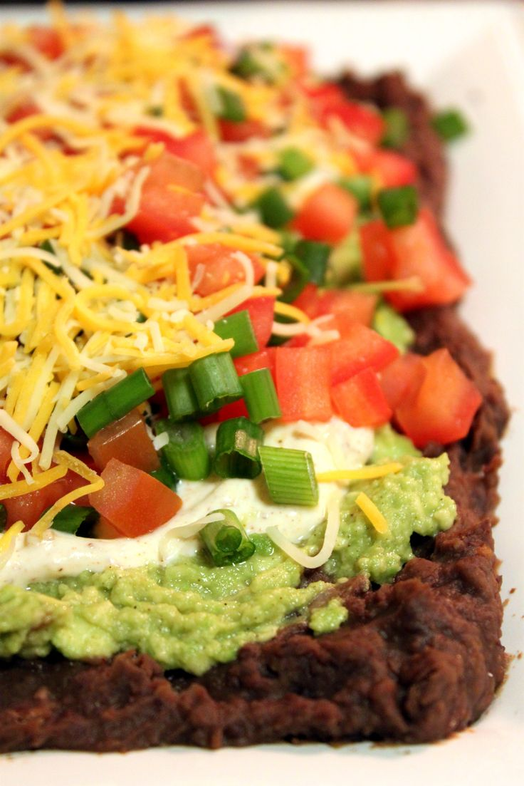 7-Layer Bean Dip - A healthy approach to a game day tradition, this is one dip that we can't get enough of!