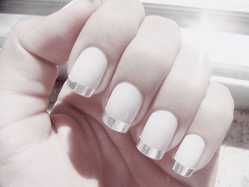 White nails with subtle sheen.