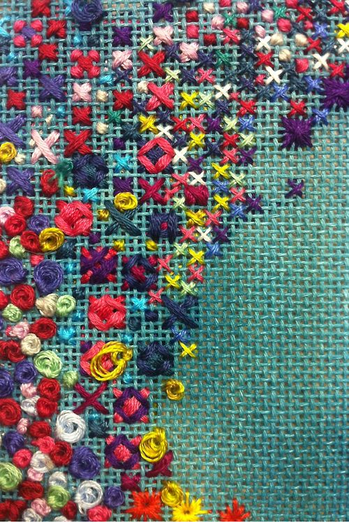 Rice stitch, loose French knots, cross stitch and rhodes stitches on liberated canvas work.