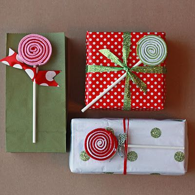 No Sew Felt Lollipops - fun for play food collection, but I also like how she used them as a way to wrap gifts!