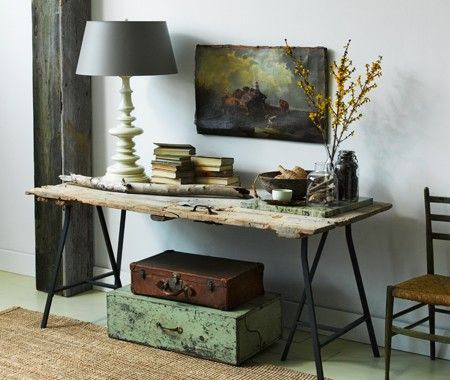 Console table made with a reclaimed barn door and Ikea trestles. From French House & Home.
