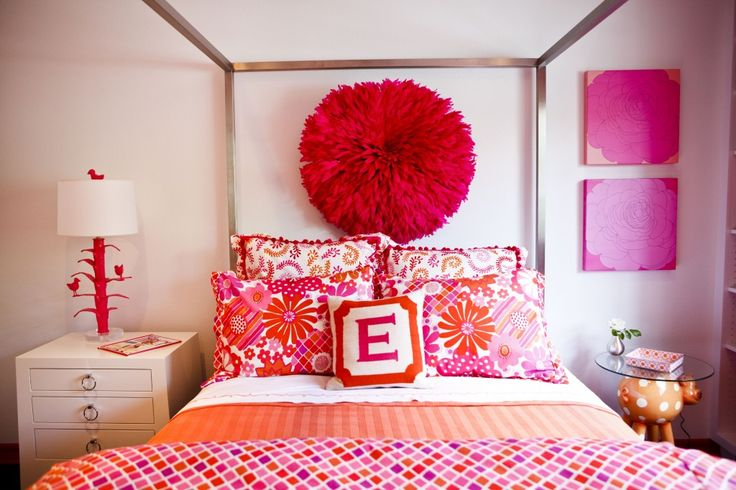 How fab is this canopy bed from @Room & Board?! We love the bold pinks + purples + orange in this #biggirlroom.