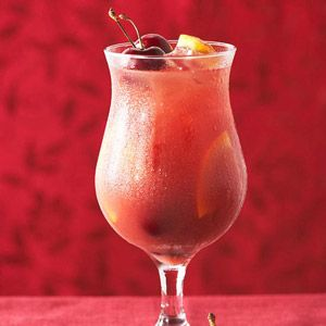 In an extra-large pitcher combine wine, brandy, cherry juice, orange ...