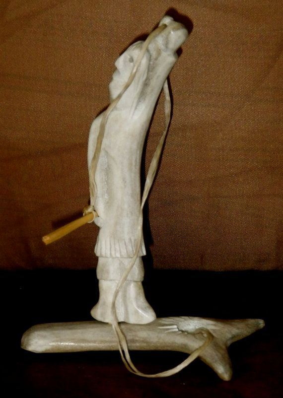 Inuit eskimo caribou antler bone carving of a fisherman