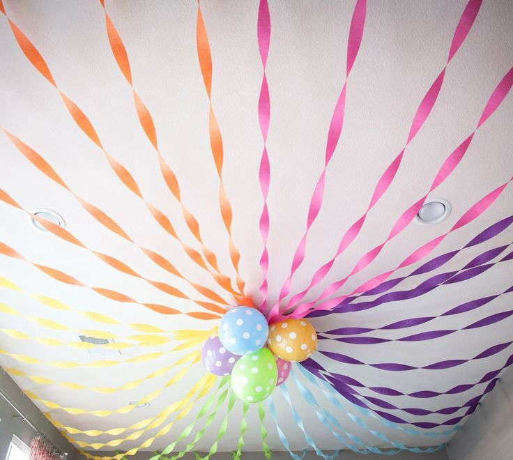 This dramatic ceiling party decor was created with crepe paper and balloons. #rainbow #partydecor