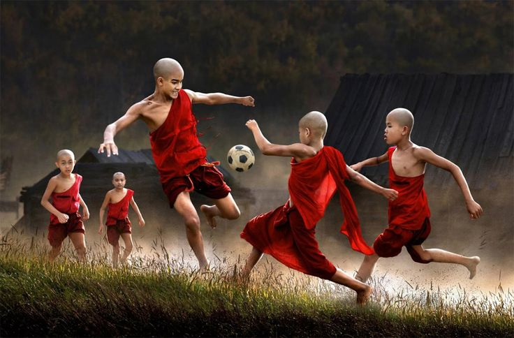 Young Buddhist monks enjoying soccer