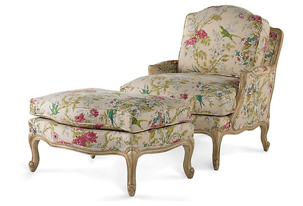 Crafted in the classic French style, this bergère and its matching ottoman are upholstered in an opulent floral fabric.