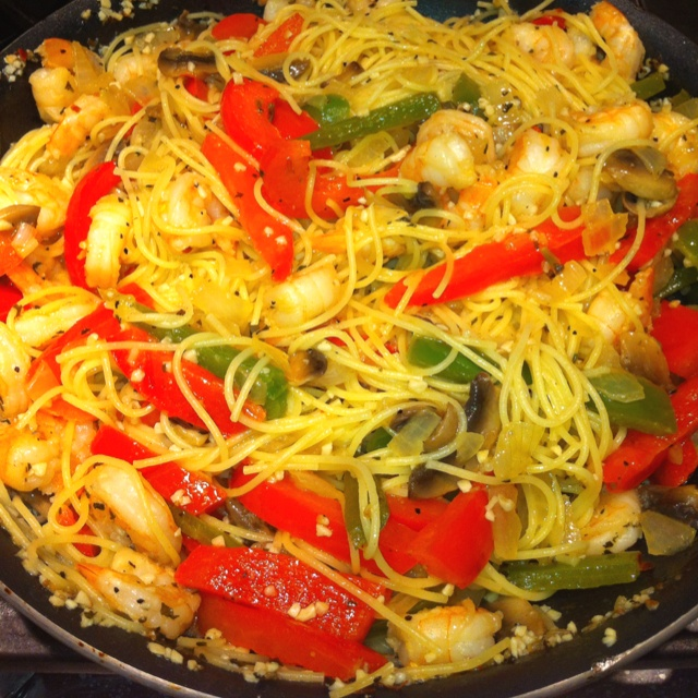 Angel hair pasta with shrimp, red and green peppers, mushrooms, and ...