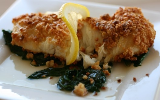 Almond-crusted Halibut Fillet over Wilted Spinach