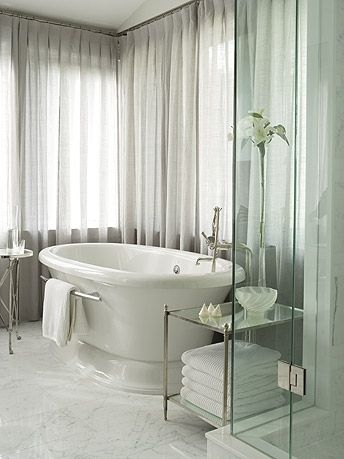 Great soaking tub and sheers that surround.