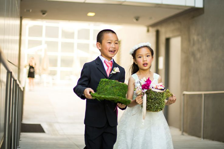 """Charming """"Alice in Wonderland"""" twist on the traditional ringbearer pillow and flower girl basket. Charleton Churchill Photography."""