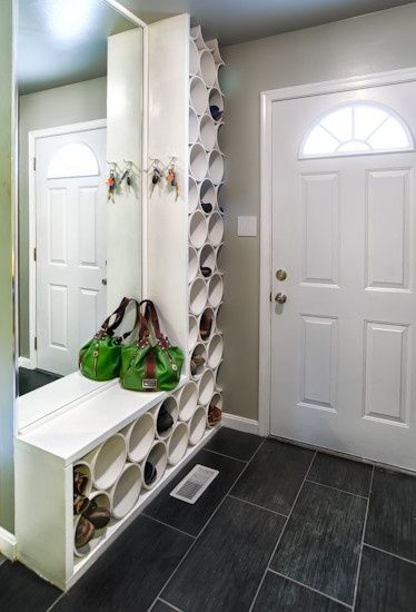 Shoe storage using cheap plastic bins, contained within shelving to give a more finished look.
