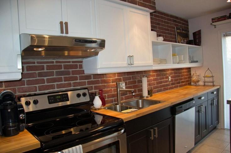 ikea butcher block countertop and brick backsplash wall stainless