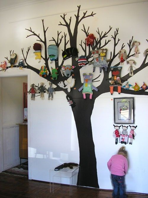 Tree motifs are as popular as ever! This room has taken the idea and made it unique with this collection of stuffed toys hung on the branches. (NOTE TO SELF: I would LOVE to paint & design something like this for any child. What a great idea for a day care area...<3)