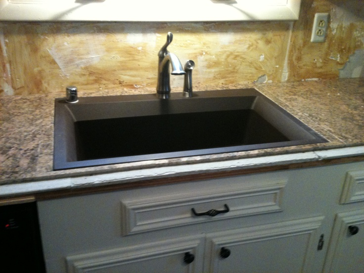 got a new kitchen sink its flush mounted with my new granite tile