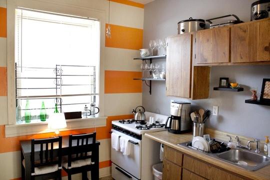 Look orange stripe wall in the kitchen kitchen spotlight for Orange kitchen walls