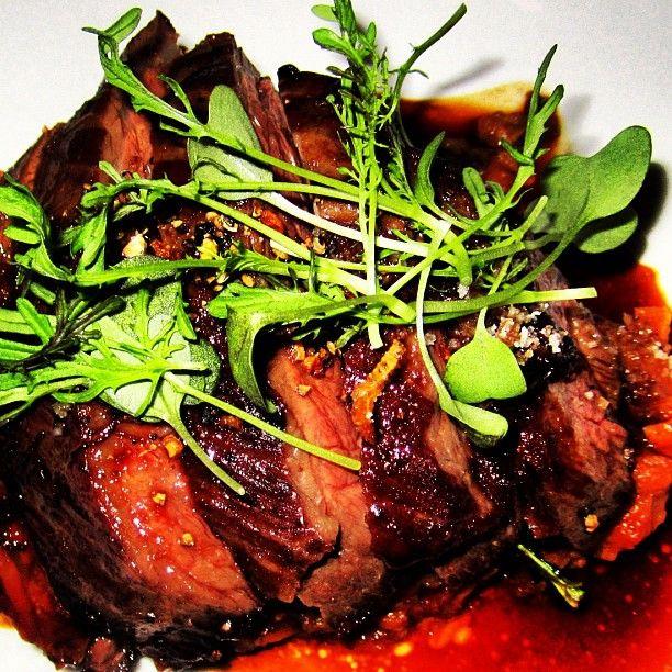 Hanger steak à la Poele with oxtail ragout, tatsoi, glazed shallots ...