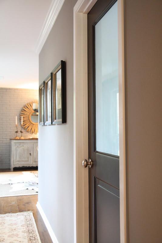 Dark Door Light Gray Wall White Trim Home Style
