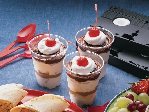 Enjoy this peanut butter sundaes-in-a-cup topped with whipped cream ...