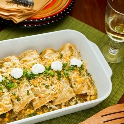 Roast chicken and corn enchiladas with a tangy tomatillo sauce, topped ...