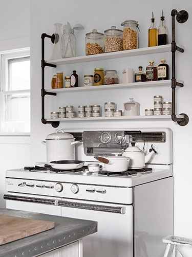 The kitchen shelves in Country Living editor Sarah Gray Miller's home were constructed from pipes and plywood.