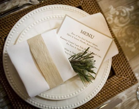 Napkin with menu & program tucked in. Raffia tied around