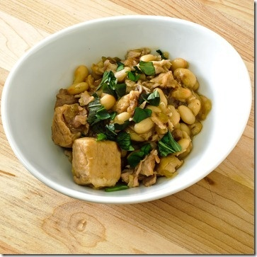 Braised pork with white beans and white wine, finished with just a bit ...