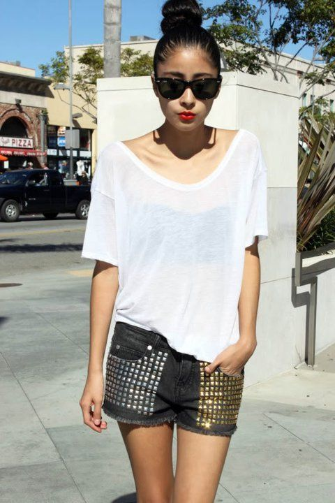 basic white t-shirt paired up with silver and gold studs