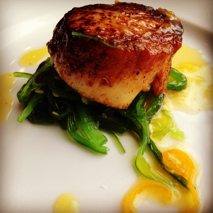 Wild scallop with seaweed salad and citrus orange reduction