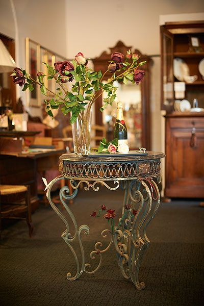 wrought iron hall table with intricate rose detail and a marble top.  Gorgeous!