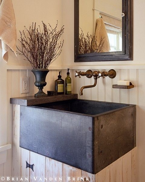 Rustic chic. Love the branches.   This sink would add a unique touch to this room.