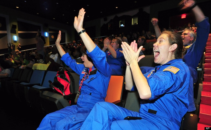 Curiosity Lands On Mars   Shannon Lampton, and Charlene Pittman, both educators with the U.S. Space and Rocket Center, cheer as they watch NASA's Mars Curiosity rover land on Mars during a special viewing event at the U.S. Space and Rocket Center Monday, Aug. 6, 2012 in Huntsville, Ala. (AP Photo/The Huntsville Times, Eric Schultz